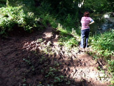 Floods wash away a footpath at Cuddling Hole, near Appleby in  2010