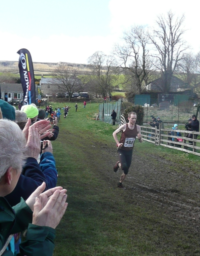 Joe Symonds crosses the finish line