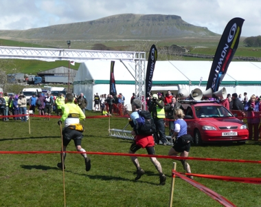 Runners race to the finish of the 58th 3 Peaks Fell Race