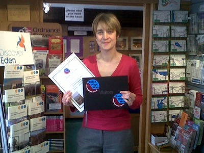 Nicola, manager of Appleby TIC with the new Dales High Way Guestbook and Certificate
