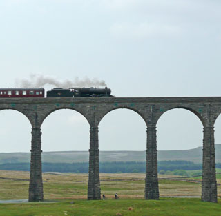 Steam train crosses Ribblehead Viaduct