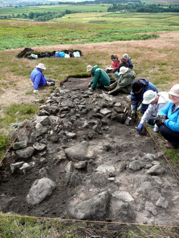 Trench G107 is opened on Stanbury Hill, found to contain an oval stone structure.